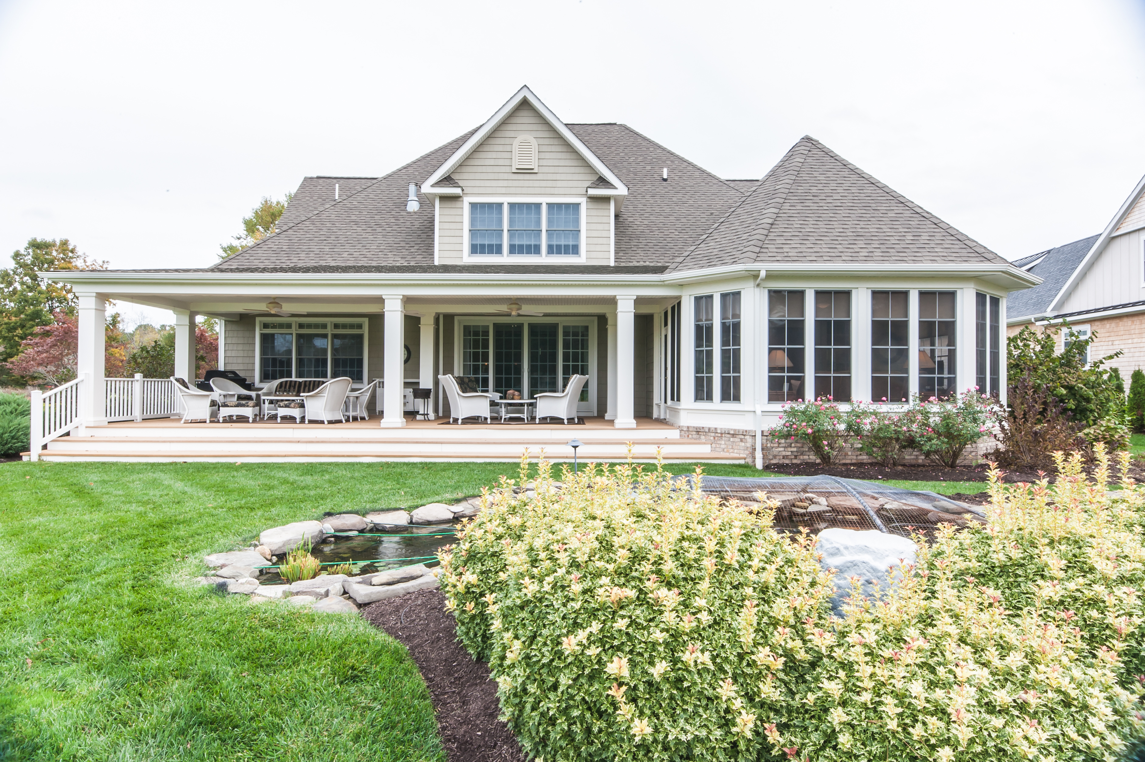 A new screened in porch revitalized this Southern Delaware golf course home.